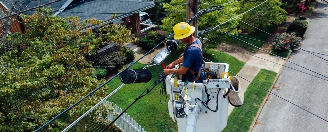 man repairing electrical wires