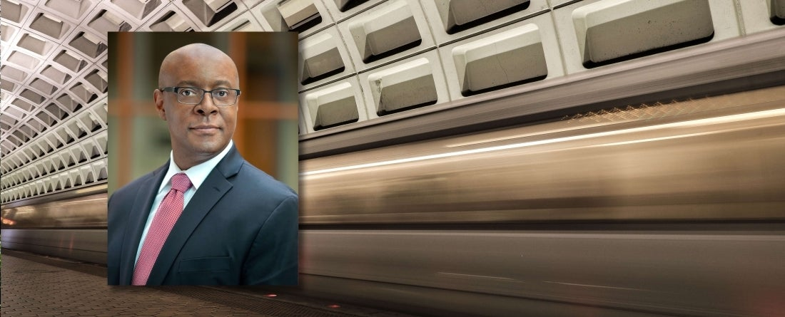 David Mussington headshot over background of fast DC metro